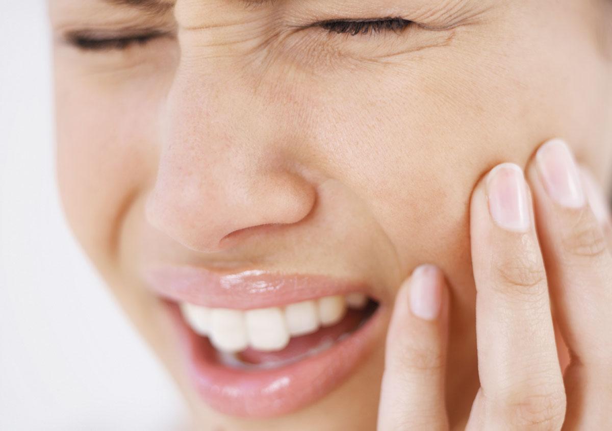 Woman having dental emergency