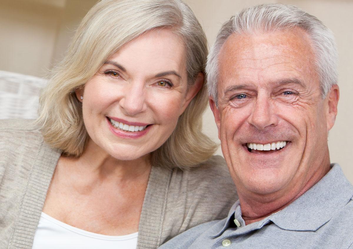 Happy senior couple sitting togethe
